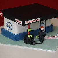 Petrol Station Cake Vanilla sponge, fondant and gumpaste decorations.