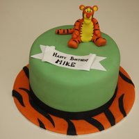 Tigger! Vanilla sponge with vanilla buttercream. Tigger made out of 50/50 paste, flowerpaste banner