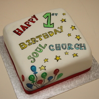Church 1St Birthday Painted using gel colours, chocolate fudge cake inside.