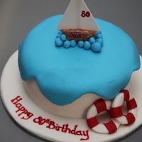 80Th Birthday Boat Vanilla sponge. Petal paste and 50/50 decorations.