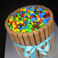 "Non-Fondant Cakes   6"" round chocolate mud cake, layered with dark chocolate ganache. Kit Kat border. M&Ms.... YUM!"