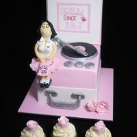 "Rock 'n' Roll Cakes Record Player Cake 6"" square Chocolate mud cake, dark choc ganache, fondant.Vanilla bean cupcakes with buttercream swirls and fondant..."