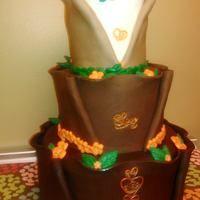 Modeling Chocolate Orange Bridal Cake ALL coverings and decorations are modeling chocolate (with the exception of the chocolate covered orange wedges in the chocolate cup on top...