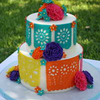 Fiesta Themed Birthday Cake Papel picado and flowers are gumpaste. Coconut cake with cream cheese filling.