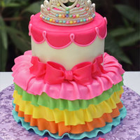 Rainbow Princess Cake Rainbow princess cake with edible gumpaste crown. Banana walnut cake with cream cheese filling.