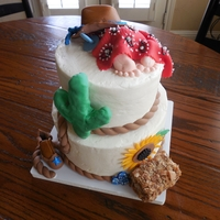Cowboy Baby Shower Not-snooth-but-as-smooth-as-I-can-figure-out buttercream; cowboy hat, boot, cactus, hat, sunflower, etc, all in gumpaste. Hay bale is RKT...