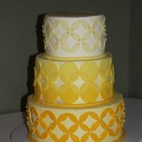 Yellow Ombre Buttercream With Yellow Ombre Fondant Accents   Inspiration - sisita. Thank you! Bride wanted a whimsical cake to go with the topper she made; this was simply perfect.