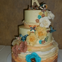 Ombre, Ruffles, Flowers, Butterflies, And Hummingbirds  All I was told was that the bride loved apricot colors and nature. Result: Ombre ruffles and roses; teal fantasy flowers. Butterflies and...