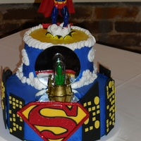 Super Groom  An over-the-top Superman cake for an over-the-top groom. Glow-in-the-dark kryptonite in front of and on top of mirrors to let the green...