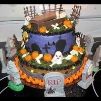 Halloween Cake My Halloween cake and first two tier. The cake is swiss chocolate with orange colored vanilla buttercream filling. It has fondant pumpkins...