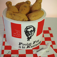 3D Kentucky Fried Chicken Cake 3D KFC Cake. The colonel is fondant (not edible impression).