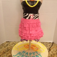 Disco Birthday Party Cake This cake was about 3 feet tall. The bodice is fondant-covered rice krispies. From the high waist down is carved cake. This was for a disco...