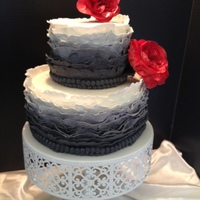 "Ombre! Ruffle Cake This two-tiered cake has a total of 28 ruffles and is emblellished with two rows of fondant ""beads"" and topped off with two..."