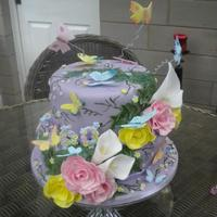 Butterflies & Flowers 60Th Birthday Cake Beatiful 2 tier Lemon Drizzle sponge cake. Covered in lilac fondant and decorated with handcrafted edible sugar butterflies, roses and...