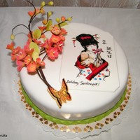 Japanese Cake With Cherry Blossom And Hand Painting Geisha Japanese cake with cherry blossom and hand-painting geisha.