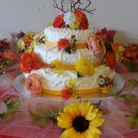 First Time Three Tier Cake My friends needed cake for their reception. She wanted a vanilla cake with lemon filling with buttercream frosting, and fall colored...