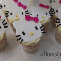 Hello Kitty Cupcakes Vanilla sponge cupcakes with raspberry filling topped with white chocolate buttercream and handmade toppers.