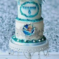 Frozen Cake Part Ii Frozen cake part 2! This time I used Cake Lace flowers in icy white and blue. The edges of the cake and plaque are decorated with homemade...