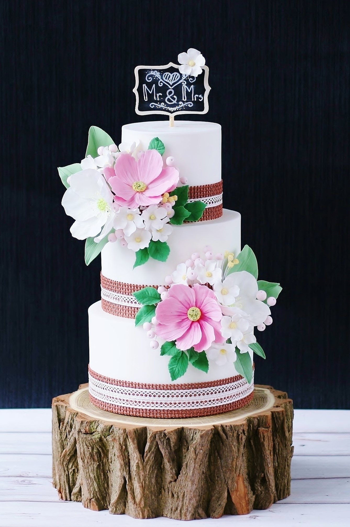 Rustic Cake Rustic cake with chalkboard, edible burlap and lace, field flowers and wood slice cake stand. Unfortunately the weather is too bad to take...