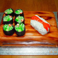 Sushi Cake everything is hand made and edible rice was rolled one by one