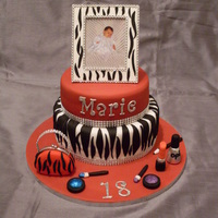 18Th Birthday First attempt at making a two tier cake, accessories are made out of fondant and the frame on top of the cake is made out of gumpaste.
