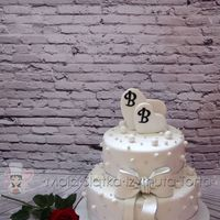 Two Hearts With A Bow Wedding Cake