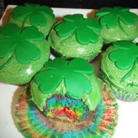 St. Patrick's Day Cupcakes A green mouth counts too ya know! Rainbow cupcakes topped with green buttercream and a fondant shamrock.