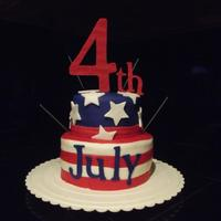 "Two Tiers Covered In Fondant And Decorated With Fondant 4Th And July Cut From Cricut Sparklers For Added Fun Two tiers covered in fondant and decorated with fondant. ""4th"" and ""July"" cut from Cricut. Sparklers for added fun!"
