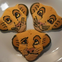 Disney Lion King Simba And Nala Cookies simba from lion king sugar cookies using royal icing - printed a picture of simba then my dad cut out a piece of wood used big circle...