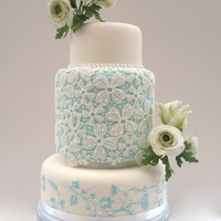 """something Blue"" Lace and hand painted cake with sugar Ranunculus and Parrot Tulips"