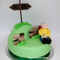 Ramber / Walker / Hiker Cake Made for a keen rambler. He's having a little rest against his backpack & dry stone wall...well he is 70! ;)