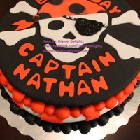 1St Birthday Pirate Themed Cake   Vanilla cake decorated with fondant and coloured sugar.