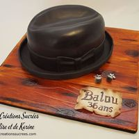 Classical Men's Hat *The board is covered in half/half gumpaste and fondant. I carved it as wood and hand painted it.