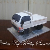 Hyundai Truck Groom Cake Hyundai truck carved from a light fruit cake and covered with fondant and parts modeled from gum paste and fondant