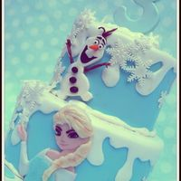 Frozen A Frozen themed cake . The characters are made with fondant and hanpainted