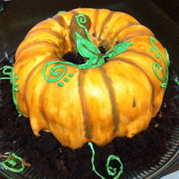 Fall Pumpkin! Made after seeing the pumpkin cake recipe on Cake Central! Chocolate cake but using two bundt cakes worked perfectly :)