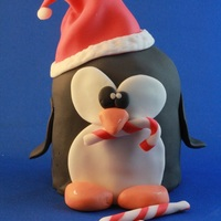 A Penguin a lot of activities for Christmas. 1st one is stealing candies....