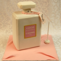 Chanel Mademoiselle Perfume Bottle Vanilla cake with chocolate hazelnut ganache.Cover with fondant.