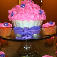Giant Cupcake Is Chocolate And 60 Cupcakes Are Strawberry This Order Was For A Beautiful Lady Turning 90 Giant cupcake is chocolate, and 60 cupcakes are strawberry. This order was for a beautiful lady turning 90!