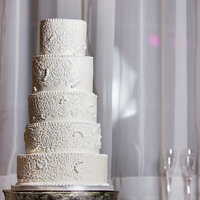 Classic White Classic white wedding cake. I had a hand cramp when I was done though!