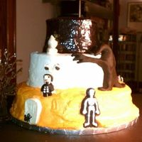 Halloween Cakes This is an Edward Gorrey themed cake for a friend's party. The top has sparkle gel mixed in teh buttercream. Characters are molded...
