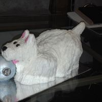 Westie Christmas Cake West Highland White Terrier aka Westie playing with a Christmas bulb. This is a carved cake with RKT tail, ears, and Christmas bulb. The...