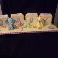 Baby Blocks baby blocks cake covered with white chocolate fondant, figurines are made of cold porcelain, pacifier made of gumpaste