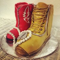 Cowgirl Boot And Combat Boot With Pearls And Dog Tags A Soldier And His Wife Yellow Cake With Buttercream Icing In The Middle All Convere  Cowgirl boot and combat boot with pearls and dog-tags, a soldier and his wife. Yellow cake with buttercream icing in the middle, all...