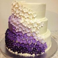 Purple Ombre Marshmallow Fondant Flowers On This Wedding Cake With Monogram Red Velvet On Bottom Tier And Confetti On Top Two Tiers With R... Purple ombre marshmallow fondant flowers on this Wedding cake with monogram. Red velvet on bottom tier, and confetti on top two tiers with...