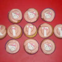 Hello Kitty   vanilla cupcakes with strawberry buttercream, handmade decorations
