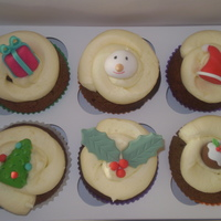 Christmas Cupcakes   Chocolate cupcakes with vanilla btc and handmade christmas decorations