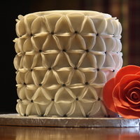 Floral Origami Cake Created From Fondant Circles Which Are Pleated Into Triangles And Placed In Alternating Directions Rose Made Of Modeli... Floral Origami Cake. Created from Fondant Circles which are pleated into triangles and placed in alternating directions. Rose made of...
