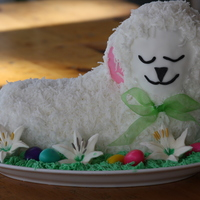Chocolate Easter Lamb Cake Covered In Coconut To Give The Fur Effect Face And Ears Covered In Fondant Easter Lilies Made With Royal Icing Chocolate Easter Lamb Cake covered in coconut to give the fur effect. Face and ears covered in fondant. Easter Lilies made with royal icing...