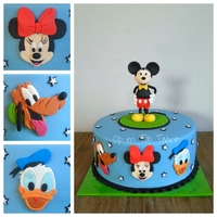 Mickey Mouse & Friends Cake This cake was ordered by a grandfather for his 3 grandchildren which are crazy about Mickey Mouse!